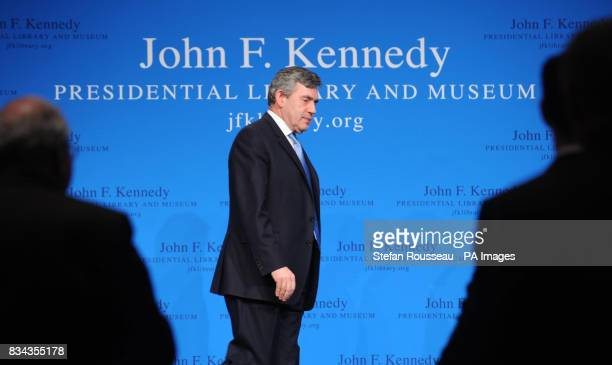 Prime Minister Gordon Brown leaves the stage after delivering a speech at the John F Kennedy Library in Boston today to an audience of business...