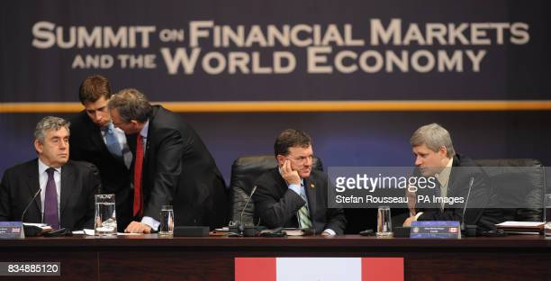 Prime Minister Gordon Brown left at the first session of the Summit on Financial Markets and the World Economy alongside Canadian PM Stephen Harper...