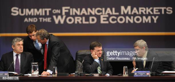 Prime Minister Gordon Brown left at the first session of the Summit on Financial Markets and the World Economy with Canadian PM Stephen Harper and...