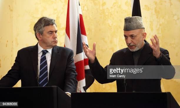 Prime Minister Gordon Brown listens President Hamid Karzai speaks at a press conference at Kandahar Airbase on December 13 2009 in Kandahar...