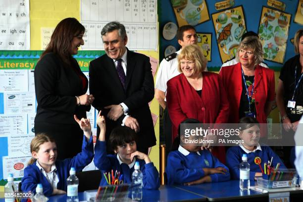 Prime Minister Gordon Brown listens to a class discussing antisocial behaviour at Anglesey Primary School in Burton on Trent