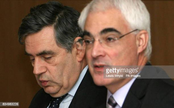 Prime Minister Gordon Brown listens to Chancellor Alistair Darling at the new Regional Economic Council inside the Department for Business Enterprise...