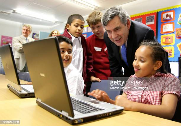 Prime Minister Gordon Brown meets children during his visit to Rolls Cresent Primary School in Hulme Manchester