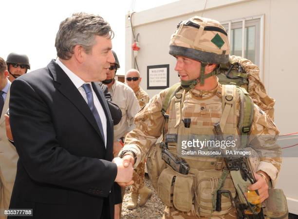 Prime Minister Gordon Brown meets Private Leon Wilson of the 2nd Mercier who had a lucky escape last last week when a bullet fired at him struck his...