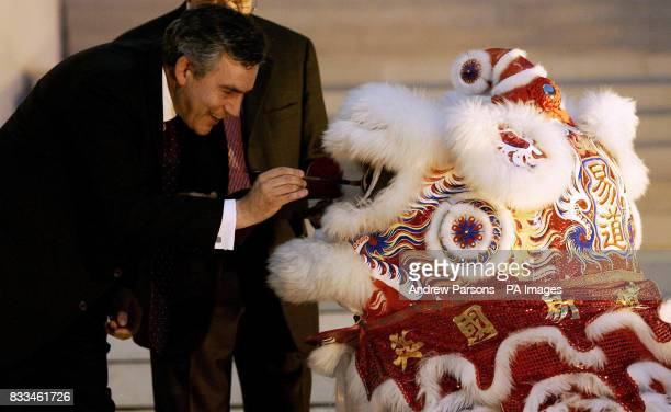 Prime Minister Gordon Brown officially opens the Terracotta Army exhibition this evening at the British Museum by painting the dragon's eyes