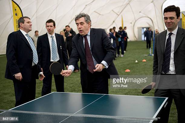 Prime Minister Gordon Brown plays table tennis with Culture Media and Sport Secretary Andy Burnham looks on during a visit to Tottenham Hotspur's...