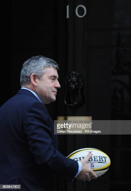 Prime Minister Gordon Brown returns to Number 10 after posing for photographs with rugby player Lawrence Dallaglio with double amputee Derek...