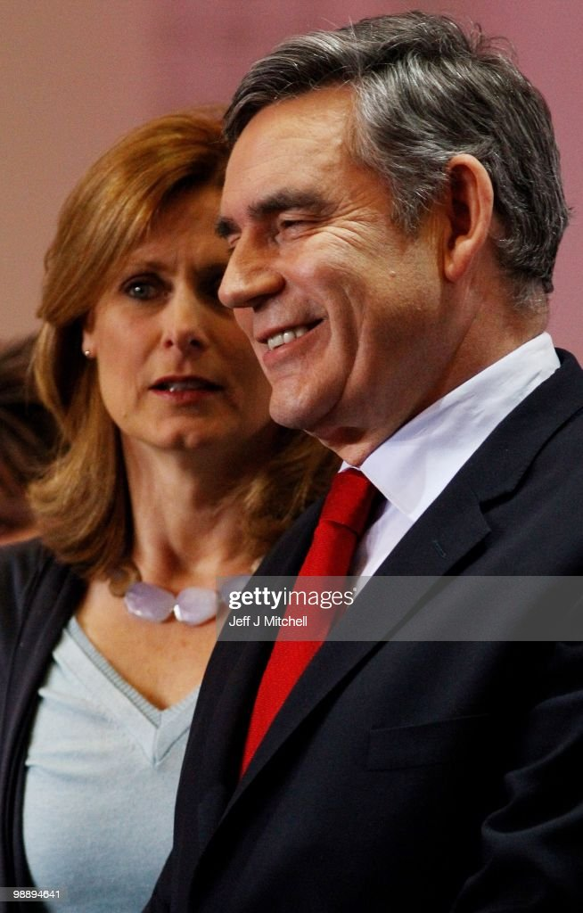 Prime Minister Gordon Brown smiles as his wife Sarah looks on after retaining his parliamentary seat on May 7, 2010 in Kirkcaldy, Scotland. After 5 weeks of campaigning, including the first ever live televised Leader's Debates, opinion polls suggest that the UK is facing the prospect of a hung parliament for the first time since 1974.
