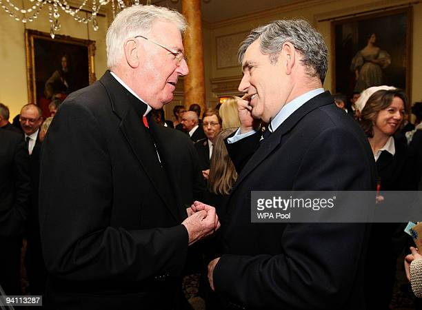 Prime Minister Gordon Brown speaks to Cardinal Cormac Murphy O'Connor attends a Christian Christmas Tea Party at 10 Downing Street on November 7 2009...
