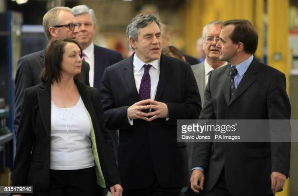 Prime Minister Gordon Brown speaks with Production Director Julia Hunt and Executive Chairman Graham Fowler during his visit to the glazing firm...