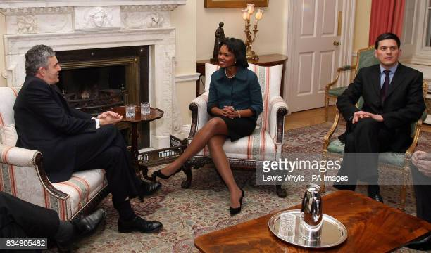 Prime Minister Gordon Brown speaks with US Secretary of State Condoleezza Rice as Foreign Secretary David Miliband looks on inside 10 Downing Street...