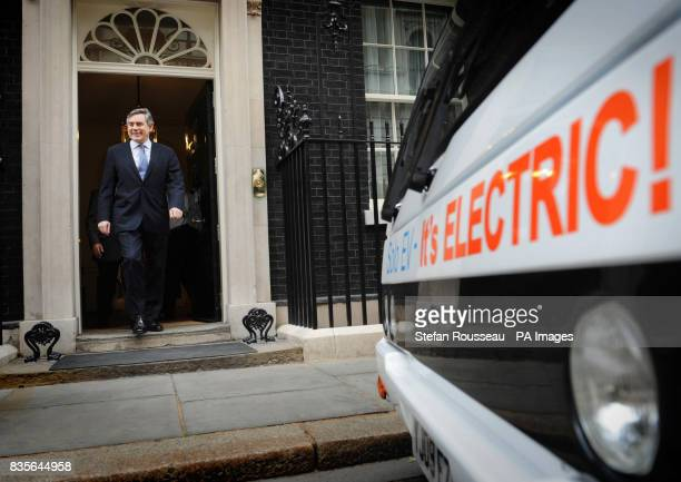 Prime Minister Gordon Brown takes a look at the first readyforservice fully batterypowered bus in Downing Street London ahead of an announcement by...