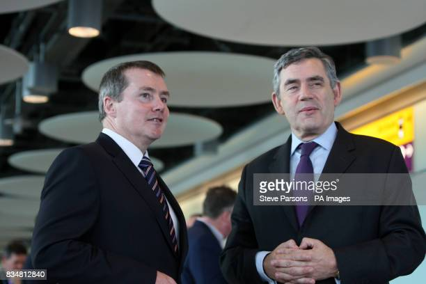 Prime Minister Gordon Brown with BA CEO Willie Walsh as they meet the Great Britain Paralympic team as they get off the plane from Beijing at...