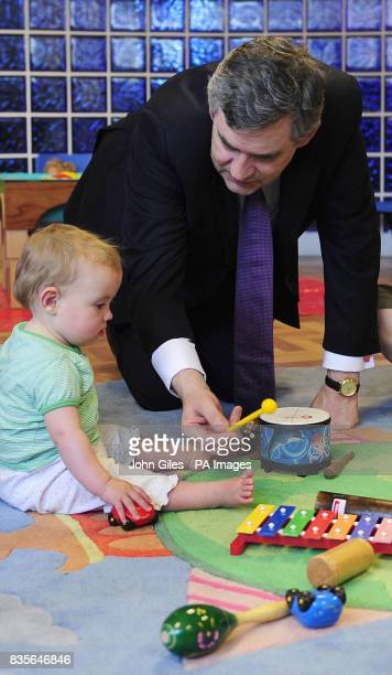 Prime Minister Gordon Brown with youngsters during a visit to a children's playgroup at Sherburn in Elmet near Leeds today as he continues his...