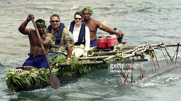 Prime Minister Helen Clark onboard a canoe as locals make their way to shore with Falani Aukuso Director of National Public service Tokelau at Afafu...