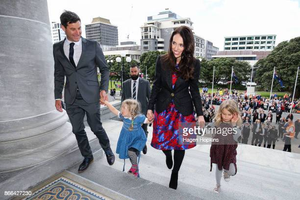 Prime Minister Jacinda Ardern and partner Clarke Gayford along Gayford's nieces Rosie and Nina Cowan arrive at Parliament after a swearingin ceremony...