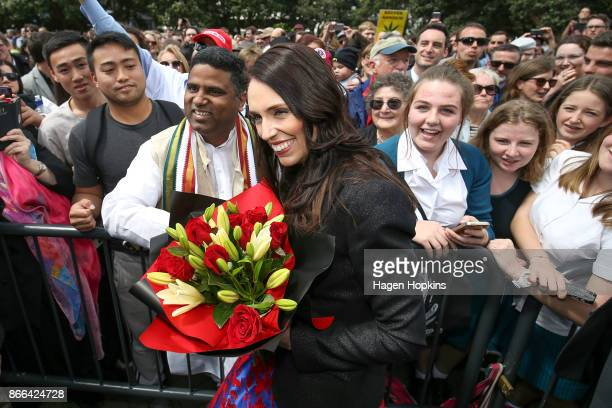 Prime Minister Jacinda Ardern is Greeniven a bunch of flowers while arriving at Parliament after a swearingin ceremony at Government House on October...