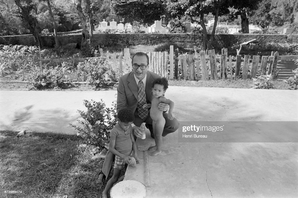 Prime Minister Jacques Chirac playing with children at the seaside, 22nd December 1975