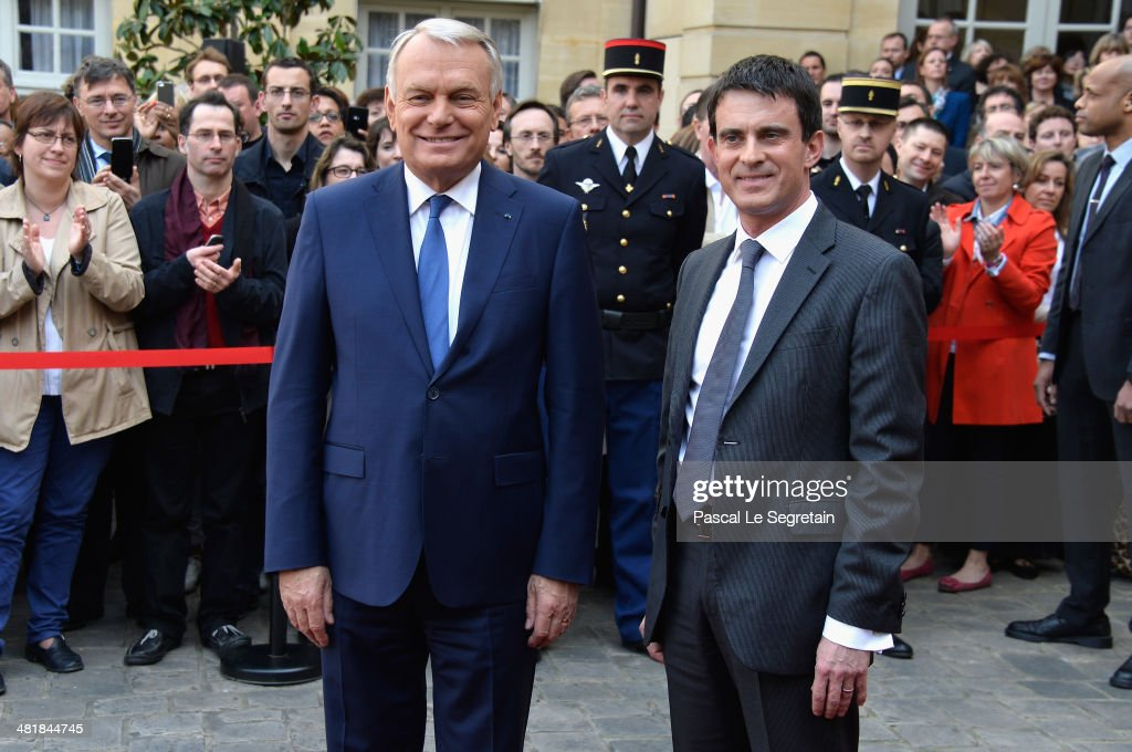 Prime minister Jean-Marc Ayrault (L) and France's newly appointed Prime minister Manuel Valls (R) attend the take over ceremony, while power is transferred to Manuel Valls after the resignation of French Prime minister Jean-Marc Ayrault at Hotel Matignon on April 1, 2014 in Paris, France.