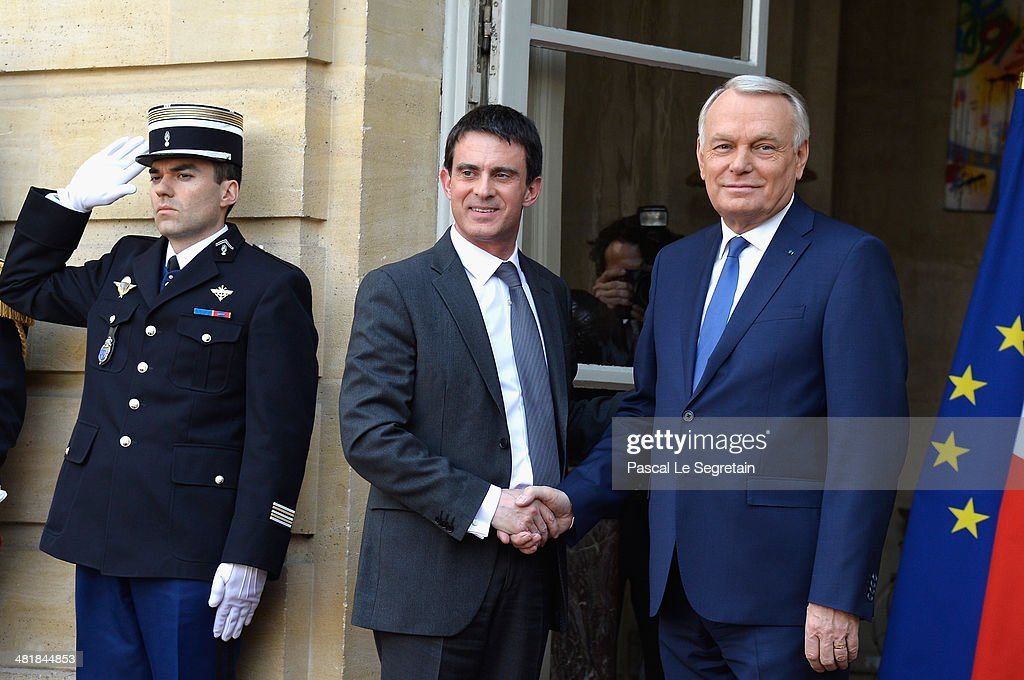 Prime minister <a gi-track='captionPersonalityLinkClicked' href=/galleries/search?phrase=Jean-Marc+Ayrault&family=editorial&specificpeople=551961 ng-click='$event.stopPropagation()'>Jean-Marc Ayrault</a> (R) and France's newly appointed Prime minister <a gi-track='captionPersonalityLinkClicked' href=/galleries/search?phrase=Manuel+Valls&family=editorial&specificpeople=2178864 ng-click='$event.stopPropagation()'>Manuel Valls</a> (L) attend the take over ceremony, while power is transferred to <a gi-track='captionPersonalityLinkClicked' href=/galleries/search?phrase=Manuel+Valls&family=editorial&specificpeople=2178864 ng-click='$event.stopPropagation()'>Manuel Valls</a> after the resignation of French Prime minister <a gi-track='captionPersonalityLinkClicked' href=/galleries/search?phrase=Jean-Marc+Ayrault&family=editorial&specificpeople=551961 ng-click='$event.stopPropagation()'>Jean-Marc Ayrault</a> at Hotel Matignon on April 1, 2014 in Paris, France.