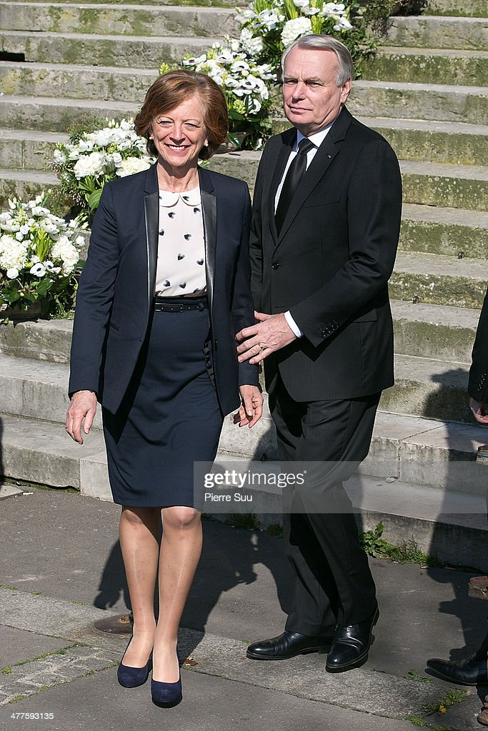 Prime minister Jean-marc Ayrault and his wife Brigitte attend the funeral of French Director Alain Resnais at Eglise Saint Vincent de Paul on March 10, 2014 in Paris, France.