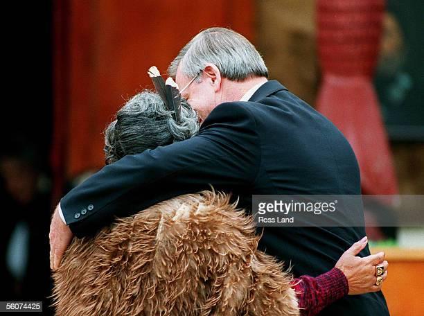 Prime Minister Jim Bolger and Maori Queen Dame Te Atairangi Kaahu embrace following the signing of the Tainui land settlement deal at Turangawaiwai...