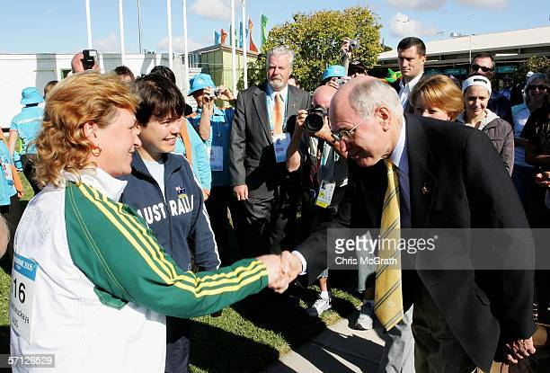 Prime Minister John Howard meets gold medalists Dina Aspandiyarova and Lalita Yauhleuskaya of Australia after the Women's 10m Air Pistol Pairs Final...