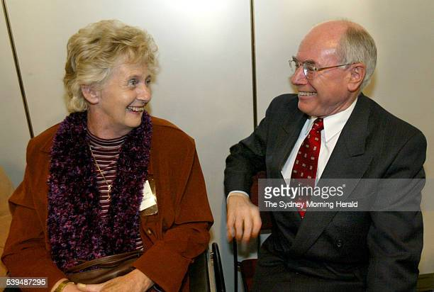 Prime Minister John Howard with MS sufferer Betty Cuthbert at the launch of Multiple Sclerosis Research Australia at Parliament House 11 August 2004...