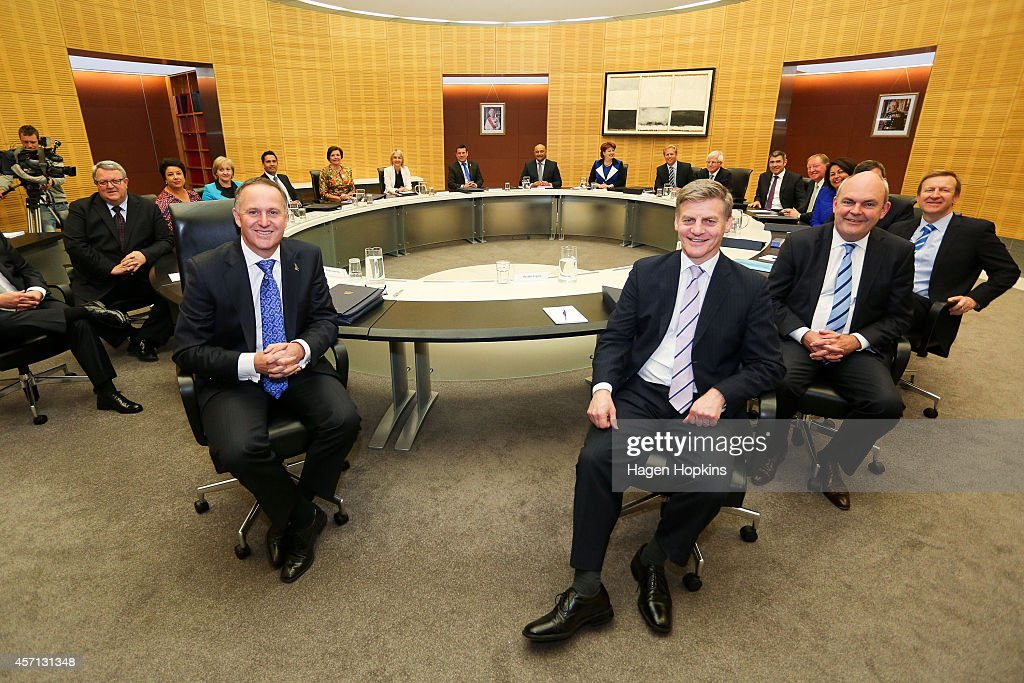 Prime Minister <a gi-track='captionPersonalityLinkClicked' href=/galleries/search?phrase=John+Key&family=editorial&specificpeople=2246670 ng-click='$event.stopPropagation()'>John Key</a> (2nd L) and Finance Minister <a gi-track='captionPersonalityLinkClicked' href=/galleries/search?phrase=Bill+English&family=editorial&specificpeople=772458 ng-click='$event.stopPropagation()'>Bill English</a> (3rd R) pose during the National Party's first cabinet meeting at The Beehive on October 13, 2014 in Wellington, New Zealand. <a gi-track='captionPersonalityLinkClicked' href=/galleries/search?phrase=John+Key&family=editorial&specificpeople=2246670 ng-click='$event.stopPropagation()'>John Key</a> became the 39th Prime Minister of New Zealand after defeating Labour opposition leader David Cunliffe in last months New Zealand general election.