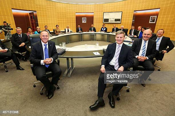 Prime Minister John Key and Finance Minister Bill English pose during the National Party's first cabinet meeting at The Beehive on October 13 2014 in...