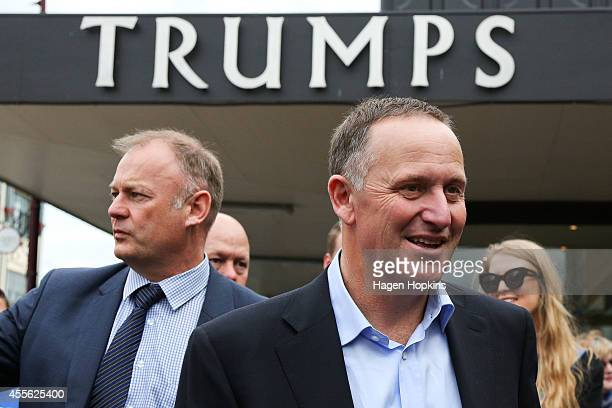 Prime Minister John Key and Palmerston North candidate Jono Naylor look on during a walkabout for the twoday National Party Bus Trip on September 18...