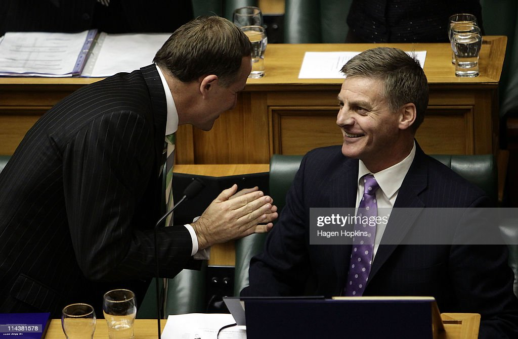 Prime Minister John Key congratulates Finance Minister Bill English after the reading of the budget at Parliament House on May 19 2011 in Wellington...