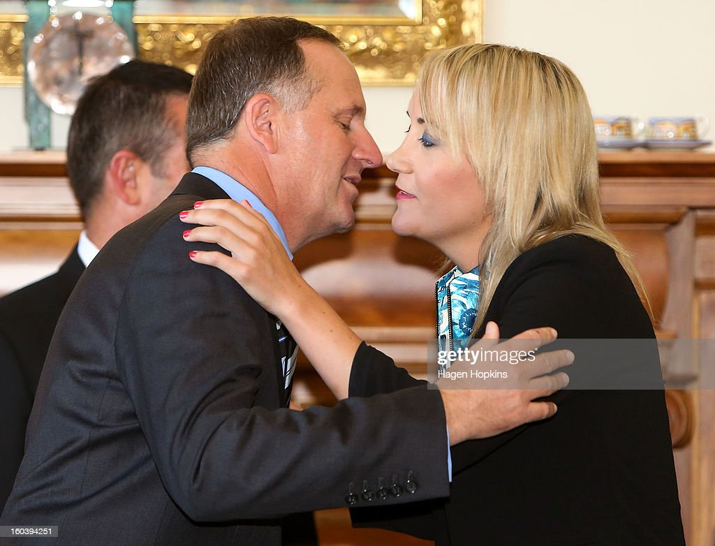 Prime Minister <a gi-track='captionPersonalityLinkClicked' href=/galleries/search?phrase=John+Key&family=editorial&specificpeople=2246670 ng-click='$event.stopPropagation()'>John Key</a> congratulates Nikki Kaye after a swearing-in ceremony at Government House on January 31, 2013 in Wellington, New Zealand. After a recent Cabinet reshuffle by Prime Minister <a gi-track='captionPersonalityLinkClicked' href=/galleries/search?phrase=John+Key&family=editorial&specificpeople=2246670 ng-click='$event.stopPropagation()'>John Key</a>, Dr Nick Smith was appointed Minister of Housing, Nikki Kaye was appointed Minister for Food Safety, Youth Affairs and Civil Defence while Michael Woodhouse was appointed as a Minister, outside of Cabinet, for Immigration and Veterans Affairs.