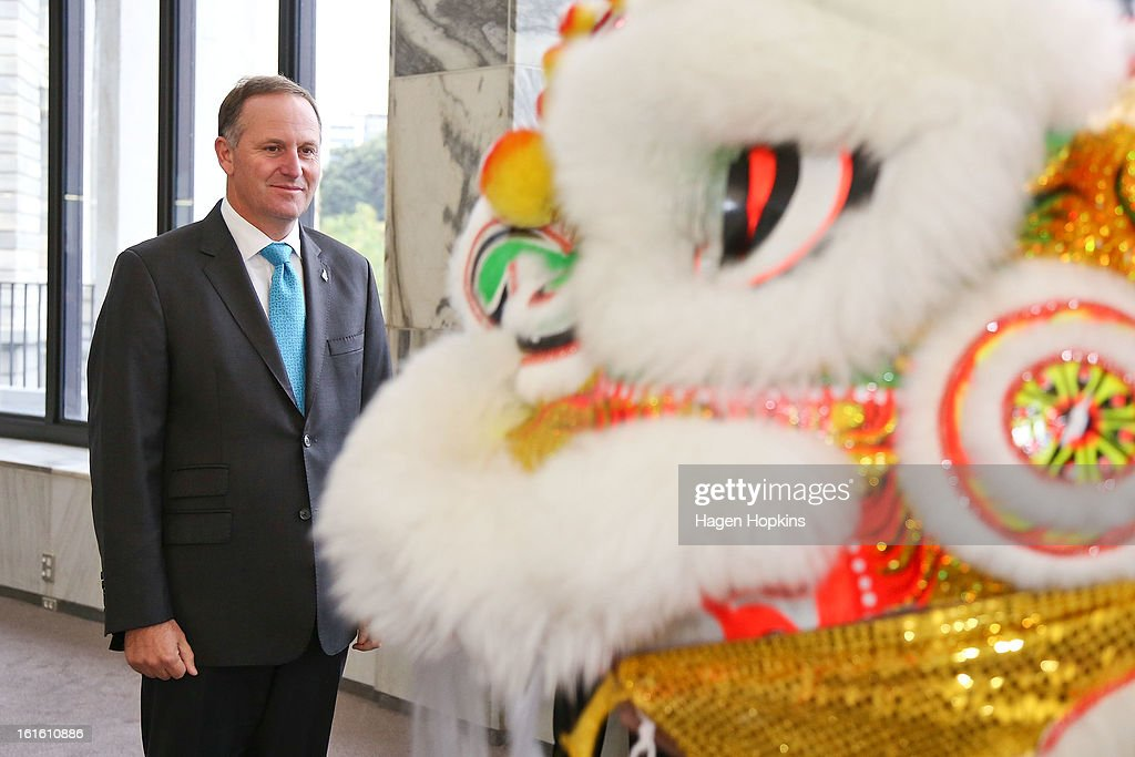 Prime Minister <a gi-track='captionPersonalityLinkClicked' href=/galleries/search?phrase=John+Key&family=editorial&specificpeople=2246670 ng-click='$event.stopPropagation()'>John Key</a> inspects a dragon during a Chinese New Year Celebration at The Beehive on February 13, 2013 in Wellington, New Zealand. Chinese New year celebrations begin on the first day of the first lunar month in the traditional Chinese calendar and end 15 days later on the full moon.
