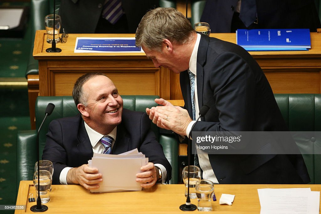 Prime Minister John Key is applauded by Finance Minister Bill English after his speech during the 2016 budget presentation at Parliament on May 26...