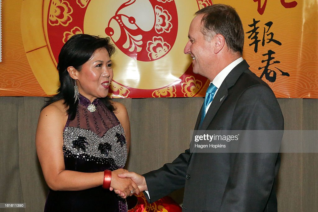 Prime Minister <a gi-track='captionPersonalityLinkClicked' href=/galleries/search?phrase=John+Key&family=editorial&specificpeople=2246670 ng-click='$event.stopPropagation()'>John Key</a> meets singer Ms Ding Man during a Chinese New Year Celebration at The Beehive on February 13, 2013 in Wellington, New Zealand. Chinese New year celebrations begin on the first day of the first lunar month in the traditional Chinese calendar and end 15 days later on the full moon.