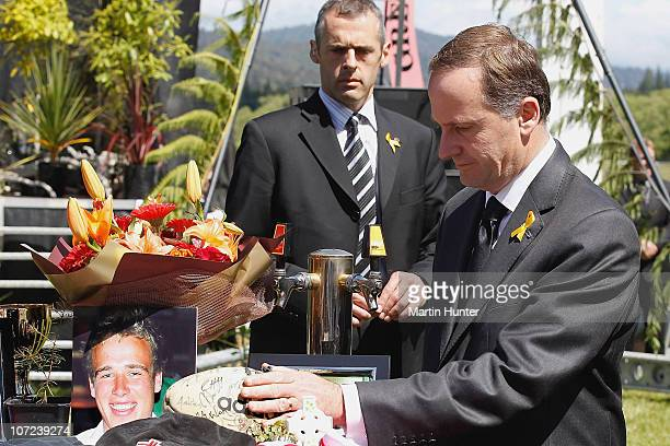 Prime Minister John Key pays his respect at a national memorial service for the 29 miners that lost their lives in the Pike River Mine at Omoto...