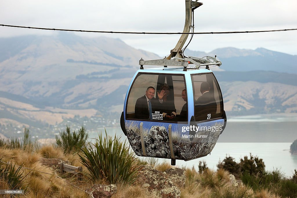 Prime Minister <a gi-track='captionPersonalityLinkClicked' href=/galleries/search?phrase=John+Key&family=editorial&specificpeople=2246670 ng-click='$event.stopPropagation()'>John Key</a> (L) rides in a Gondla pod during the re-opening of the Christchurch gondola on April 19, 2013 in Christchurch, New Zealand. The gondola was closed following the 2011 Christchurch earthquakes and has since undergone reconstruction before the official re-opening today.
