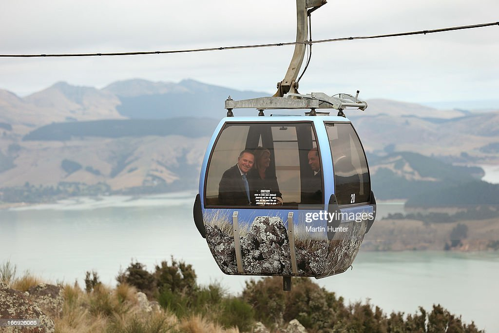 Prime Minister John Key (L) rides in a Gondla pod during the re-opening of the Christchurch gondola on April 19, 2013 in Christchurch, New Zealand. The gondola was closed following the 2011 Christchurch earthquakes and has since undergone reconstruction before the official re-opening today.