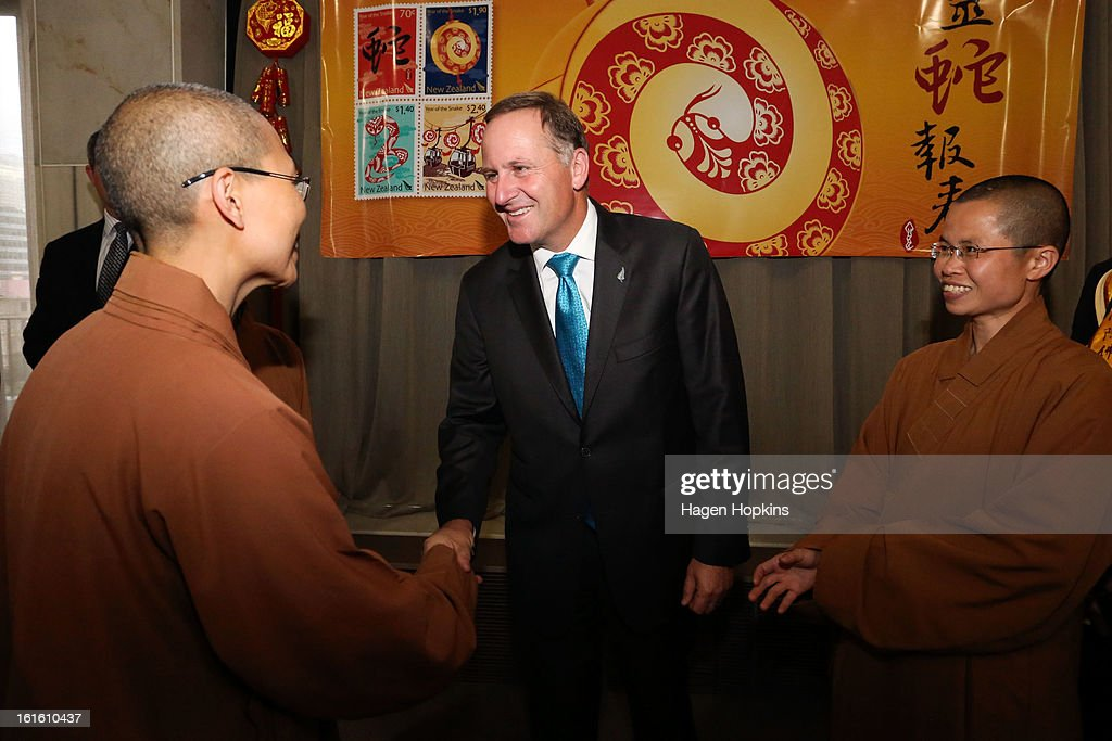 Prime Minister <a gi-track='captionPersonalityLinkClicked' href=/galleries/search?phrase=John+Key&family=editorial&specificpeople=2246670 ng-click='$event.stopPropagation()'>John Key</a> shakes hands with a member of Fo Guang Shan Buddhist Temple during a Chinese New Year Celebration at The Beehive on February 13, 2013 in Wellington, New Zealand. Chinese New year celebrations begin on the first day of the first lunar month in the traditional Chinese calendar and end 15 days later on the full moon.