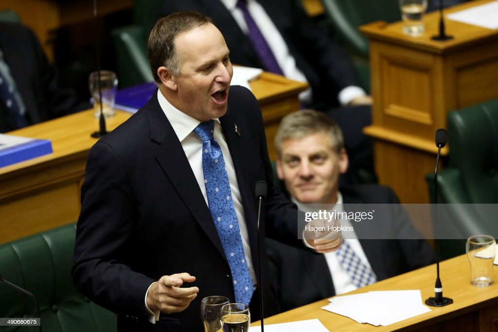 Prime Minister John Key speaks while Finance Minister Bill English looks on during the 2014 budget presentation at Parliament on May 15 2014 in...