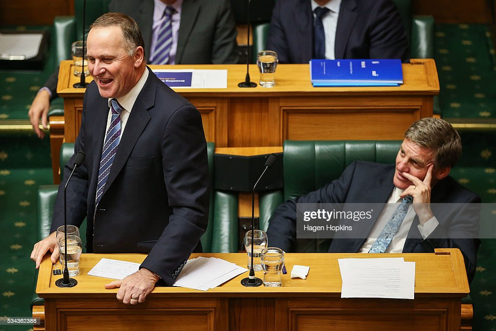 Prime Minister John Key speaks while Finance Minister Bill English looks on during the 2016 budget presentation at Parliament on May 26, 2016 in Wellington, New Zealand. English delivered his eighth budget which sees record investment in health and education and more support for businesses to create jobs on the back of a growing economy.