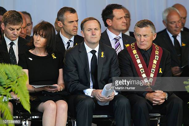 Prime Minister John Key with his wife Bronagh and Greymouth Major Tony Kokshoorn pay their respect at a national memorial service for the 29 miners...