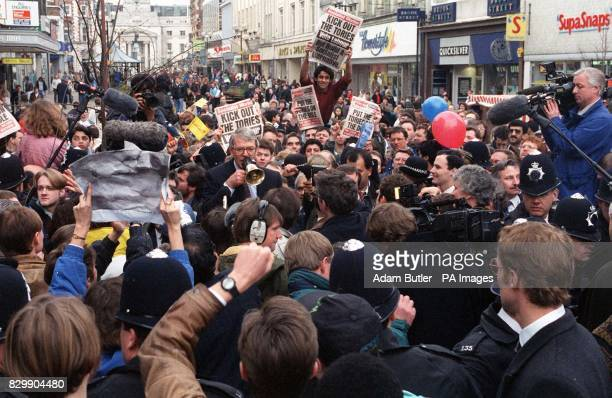 Prime Minister John Major attempts to drown out jeers and abuse from hardleft wing activists during a walkabout in Luton in a general election...