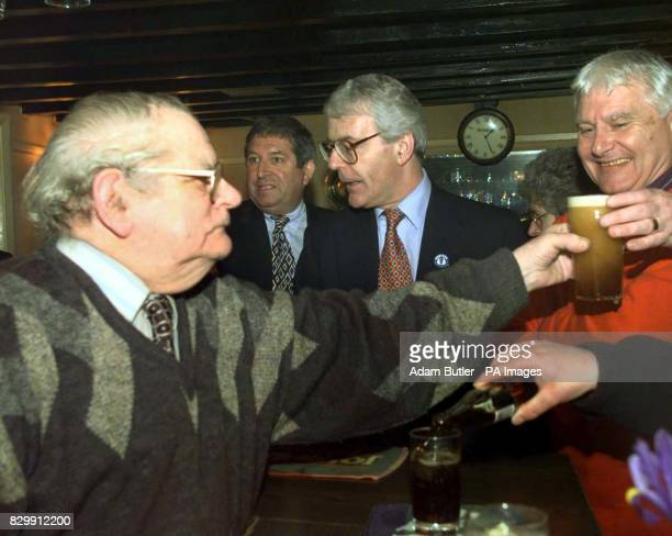 Prime Minister John Major enjoys a pint and a chat with the locals at his home constituency local pub the Market Inn of Huntington today Photo by...