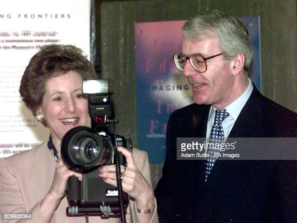 Prime Minister John Major looks on as his wife Norma tries out a digital camera at the National Museum of Photography Film and Television in Bradford...