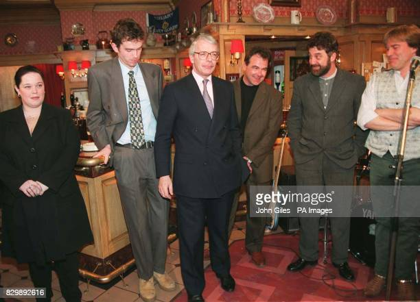 Prime Minister John Major meets members of the Emmerdale cast in the set of the Woolpack Inn during his visit to the Yorkshire TV studios this...