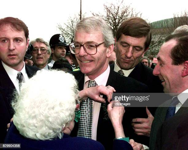 Prime Minister John Major recieves a shamrock in the crowd during his walkabout in Luton today the Bedfordshire town where he used the famous box to...