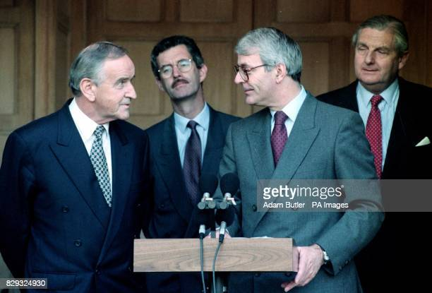 Prime Minister John Major talks to his Irish counterpart Albert Reynolds at Chequers while Irish foreign minister Dick Spring looks on