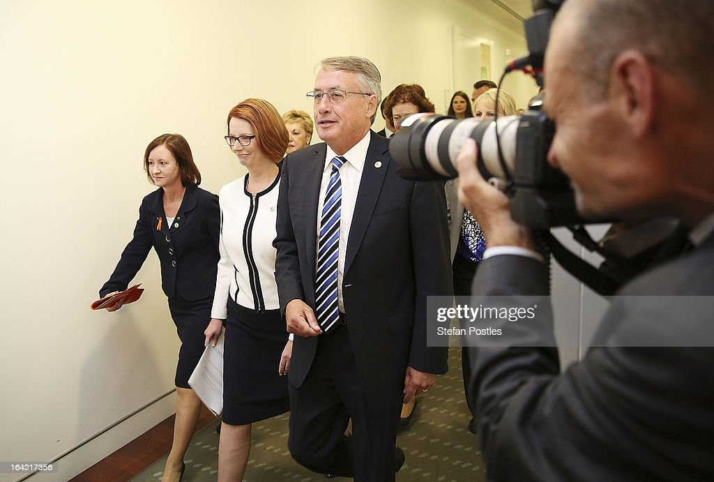 Prime Minister <a gi-track='captionPersonalityLinkClicked' href=/galleries/search?phrase=Julia+Gillard&family=editorial&specificpeople=787281 ng-click='$event.stopPropagation()'>Julia Gillard</a> and Deputy Prime Minister <a gi-track='captionPersonalityLinkClicked' href=/galleries/search?phrase=Wayne+Swan&family=editorial&specificpeople=4582809 ng-click='$event.stopPropagation()'>Wayne Swan</a> walk towards the caucus meeting on March 21, 2013 in Canberra, Australia. Australian Prime Minister <a gi-track='captionPersonalityLinkClicked' href=/galleries/search?phrase=Julia+Gillard&family=editorial&specificpeople=787281 ng-click='$event.stopPropagation()'>Julia Gillard</a> has called for a ballot today to decide the leader, and deputy leader of the Australian Labor Party, effectively a caucus vote that will decide the Prime Minister and Deputy Prime Minister of the country. In a surprise turn of events only the incumbents nominated for the positions, so <a gi-track='captionPersonalityLinkClicked' href=/galleries/search?phrase=Julia+Gillard&family=editorial&specificpeople=787281 ng-click='$event.stopPropagation()'>Julia Gillard</a> remains Prime Minister and <a gi-track='captionPersonalityLinkClicked' href=/galleries/search?phrase=Wayne+Swan&family=editorial&specificpeople=4582809 ng-click='$event.stopPropagation()'>Wayne Swan</a> stays in the role of Deputy Prime Minister.